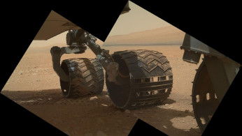 This view of the three left wheels of NASA's Mars rover Curiosity combines two images that were taken by the rover during the 34th Martian day