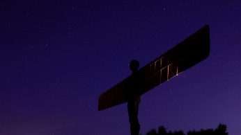 The stars shine in the sky above Antony Gormley's Angel