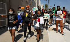 Student activist Kahlila Williams leads a march during a national day of protest