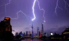 Lightning strikes are seen above the skyline of Shanghai