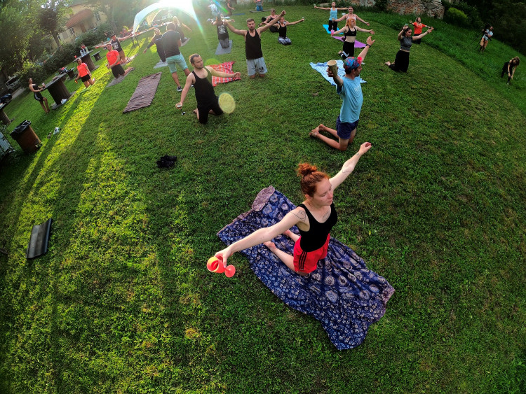 People hold glasses of wine as they perform wine yoga in Riga, Latvia August 8, 2020.