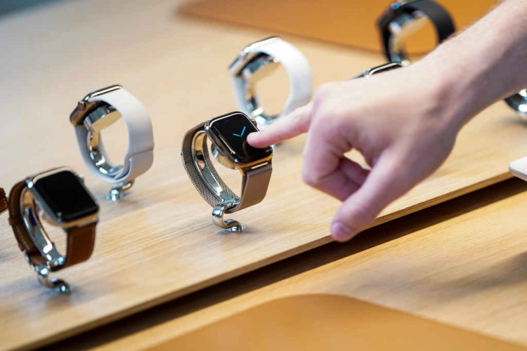 A customer checks Apple watches at the grand opening of the new Apple Carnegie Library store in Washington