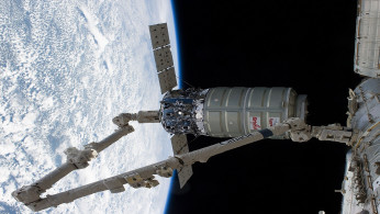 The International Space Station's Canadarm2 unberths the Orbital Sciences Corporation's Cygnus spacecraft after several weeks at the space station