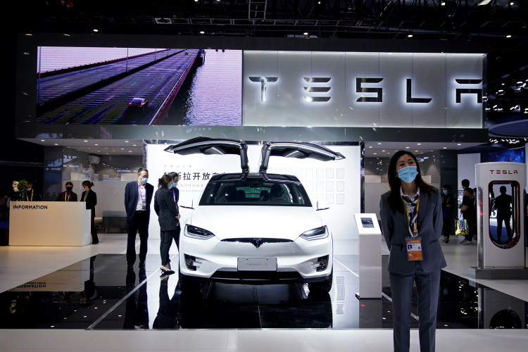 Tesla sign is seen at the third China International Import Expo (CIIE) in Shanghai