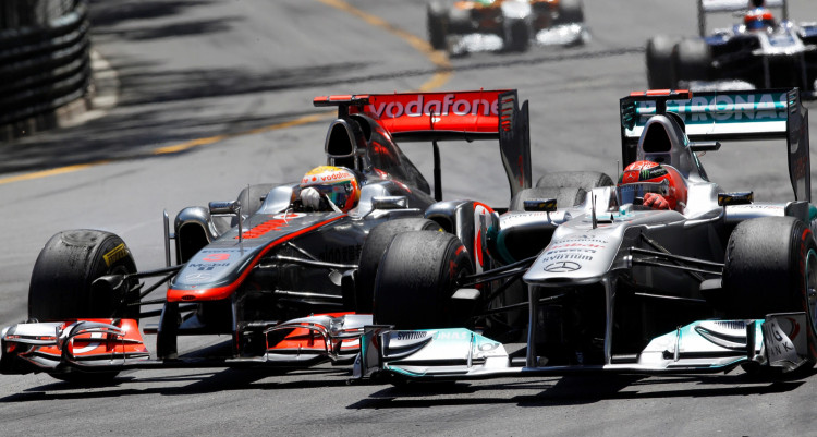 FILE PHOTO: McLaren's Hamilton overtakes Mercedes' Schumacher during the Monaco F1 Grand Prix