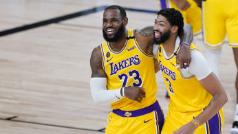 NBA: Los Angeles Lakers' LeBron James (23) and Anthony Davis (3) celebrate after defeating the Denver Nuggets 124-121