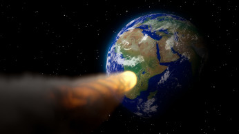An illustration of an asteroid heading for Earth.