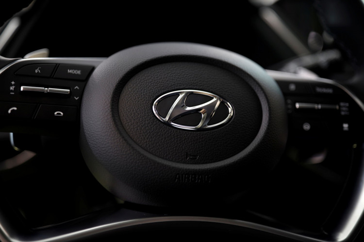 FILE PHOTO: The logo of Hyundai Motors is seen on a steering wheel on display at the company's headquarters in Seoul
