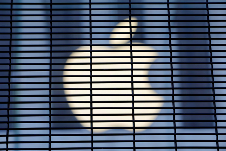 FILE PHOTO: The Apple logo is seen through a security fence erected around the Apple Fifth Avenue store