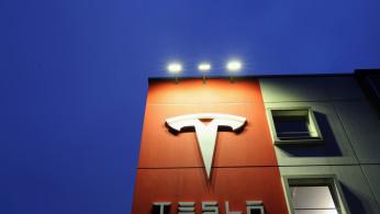A logo of car manufacturer Tesla is seen at a branch office in Bern, Switzerland December 10, 2020