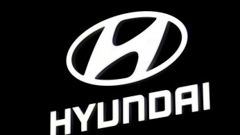 FILE PHOTO: The Hyundai booth displays the company logo at the North American International Auto Show in Detroit, Michigan, U.S. January 16, 2018