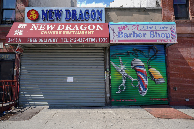 A Chinese restaurant and barber shop in Harlem are closed in New York City, New York