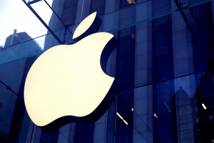 FILE PHOTO: The Apple Inc logo is seen hanging at the entrance to the Apple store on 5th Avenue in Manhattan, New York