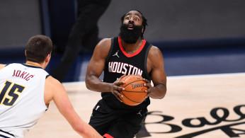 NBA: Houston Rockets guard James Harden (13) lines up a shot on Denver Nuggets center Nikola Jokic (15) in the third quarter at Ball Arena