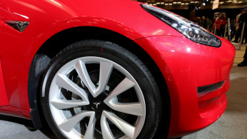 FILE PHOTO: A Tesla Model 3 electric vehicle is displayed at the Canadian International Auto Show in Toronto, Ontario, Canada February 18, 2020