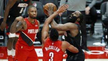 NBA: Houston Rockets shooting guard James Harden (13) is fouled while shooting by Portland Trail Blazers shooting guard CJ McCollum (3)