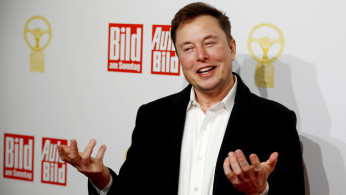 FILE PHOTO: Tesla CEO Elon Musk arrives on the red carpet for the automobile awards