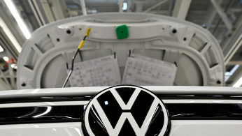 FILE PHOTO: A car stands at the production line for the electric Volkswagen cars, model ID.3 and model ID. 4, in Zwickau, Germany