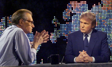 Billionaire real estate developer Donald Trump (R) talks with host Larry King after taping a segment of King's CNN talk show, in New York, U.S., October 7, 1999. REUTERS/File Photo