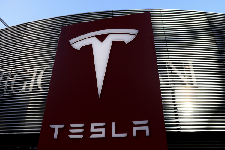 A logo of the electric vehicle maker Tesla is seen near a shopping complex in Beijing, China