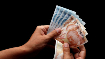 Turkish lira banknotes are seen in this picture illustration in Istanbul, Turkey.