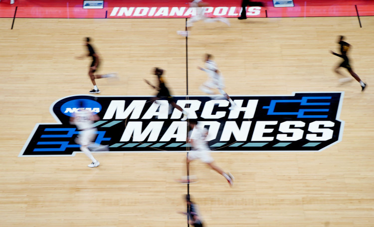 A detailed view of the March Madness logo at center court as Gonzaga Bulldogs and Norfolk State Spartans players.