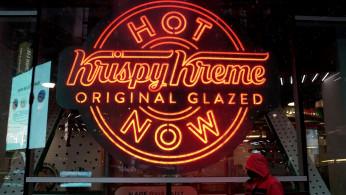 FILE PHOTO: A man walks past a Krispy Kreme