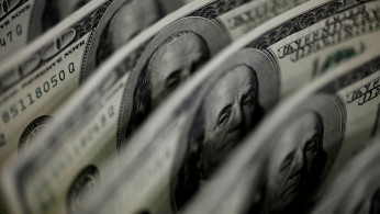 A picture illustration shows U.S. 100 dollar bank notes taken in Tokyo.