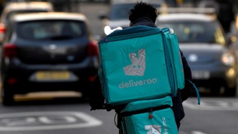 FILE PHOTO: A Deliveroo delivery rider cycles in London, Britain, March 8, 2021.