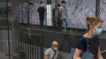 Commuters wearing protective face masks
