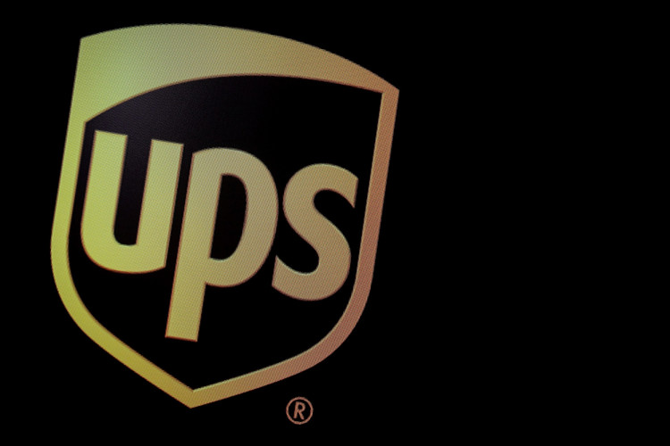 FILE PHOTO: The company logo for United Parcel Service (UPS), is displayed on a screen at the New York Stock Exchange (NYSE) in New York, U.S., October 22, 2019.