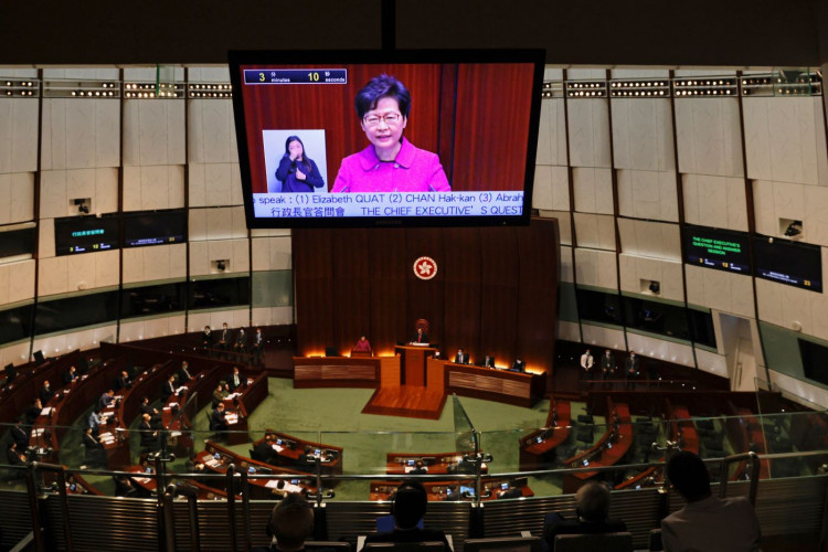 Hong Kong Chief Executive Carrie Lam is seen on a screen as she attend her quarterly update.
