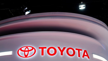 FILE PHOTO: The Toyota logo is seen at its booth during a media day for the Auto Shanghai show in Shanghai, China April 19, 2021.