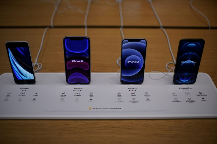 Apple's 5G iPhone 12 and iPhone 11 are seen at an Apple Store.