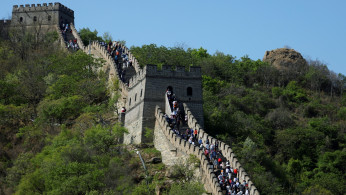 People visit the Mutianyu section of the Great Wall of China during Labour Day holiday.