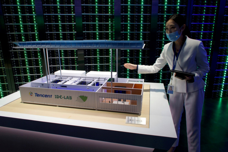 A staff member introduces Tencent's Internet Data Center (IDC) cloud computing service in Guangdong province China.