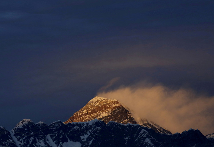 FILE PHOTO: Light illuminates Mount Everest, during sunset in Solukhumbu District also known as the Everest region, November 30, 2015.
