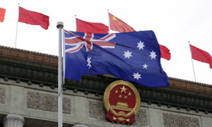 FILE PHOTO: Australian flag flutters in front of the Great Hall of the People during a welcoming ceremony for Australian Prime Minister Malcolm Turnbull (not in picture) in Beijing, China, April 14, 2016.
