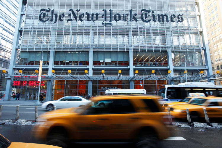FILE PHOTO: Vehicles drive past the New York Times headquarters in New York March 1, 2010.