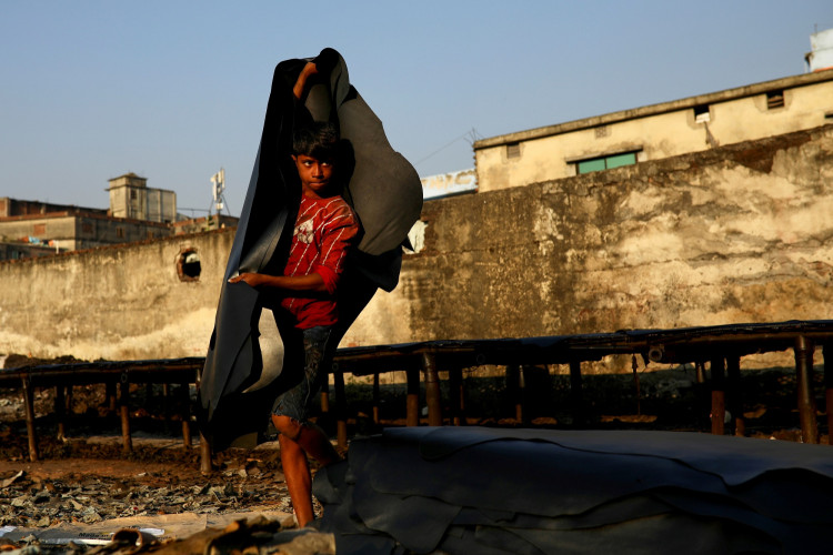 A child works in a tannery in Dhaka, Bangladesh, January 3, 2021.