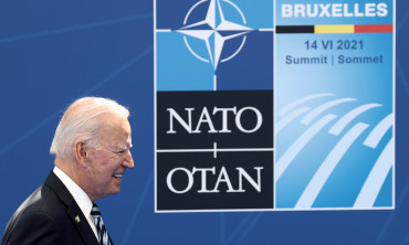 U.S. President Joe Biden arrives to pose with NATO Secretary General Jens Stoltenberg during the NATO summit at the Alliance's headquarters, in Brussels, Belgium, June 14, 2021.