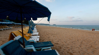 FILE PHOTO: Empty chairs are seen on a beach which is usually full of tourists, amid fear of coronavirus in Phuket, Thailand March 11, 2020.