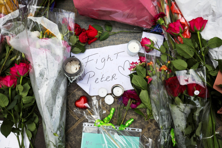 Flowers and a note rest on the place where Dutch celebrity crime reporter Peter R. de Vries has been shot.