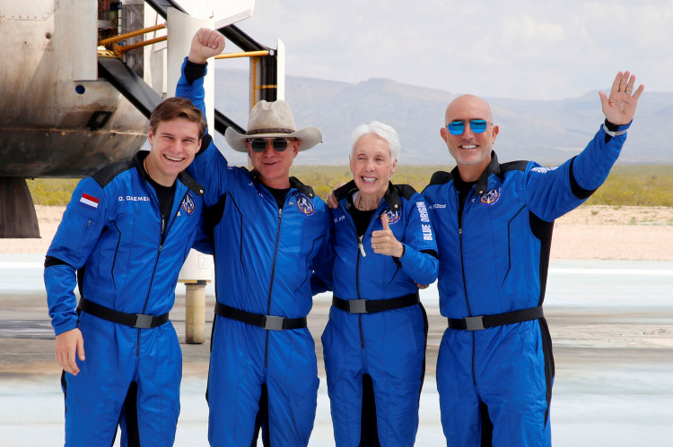 Billionaire American businessman Jeff Bezos (2nd-L) poses for pictures with crew mates