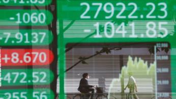 Asia Stocks Fragile Amid Growth Worries, Dollar In Demand