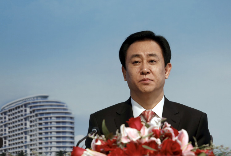 China tells Evergrande to avoid dollar bond defaults, Bloomberg reports