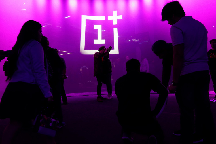 The OnePlus logo is projected onto a wall during a launch event for the new OnePlus 6T in the Manhattan borough of New York