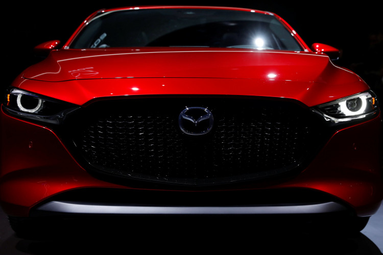 Mazda Corporation introduces the new 2020 Mazda 3 vehicle at the Los Angeles auto show in Los Angeles