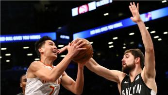 Brooklyn Nets forward Joe Harris (12) defends against Atlanta Hawks guard Jeremy Lin (7)
