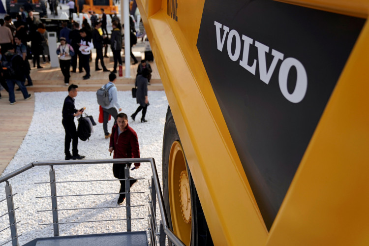 People visit heavy machinery of Volvo at Bauma China